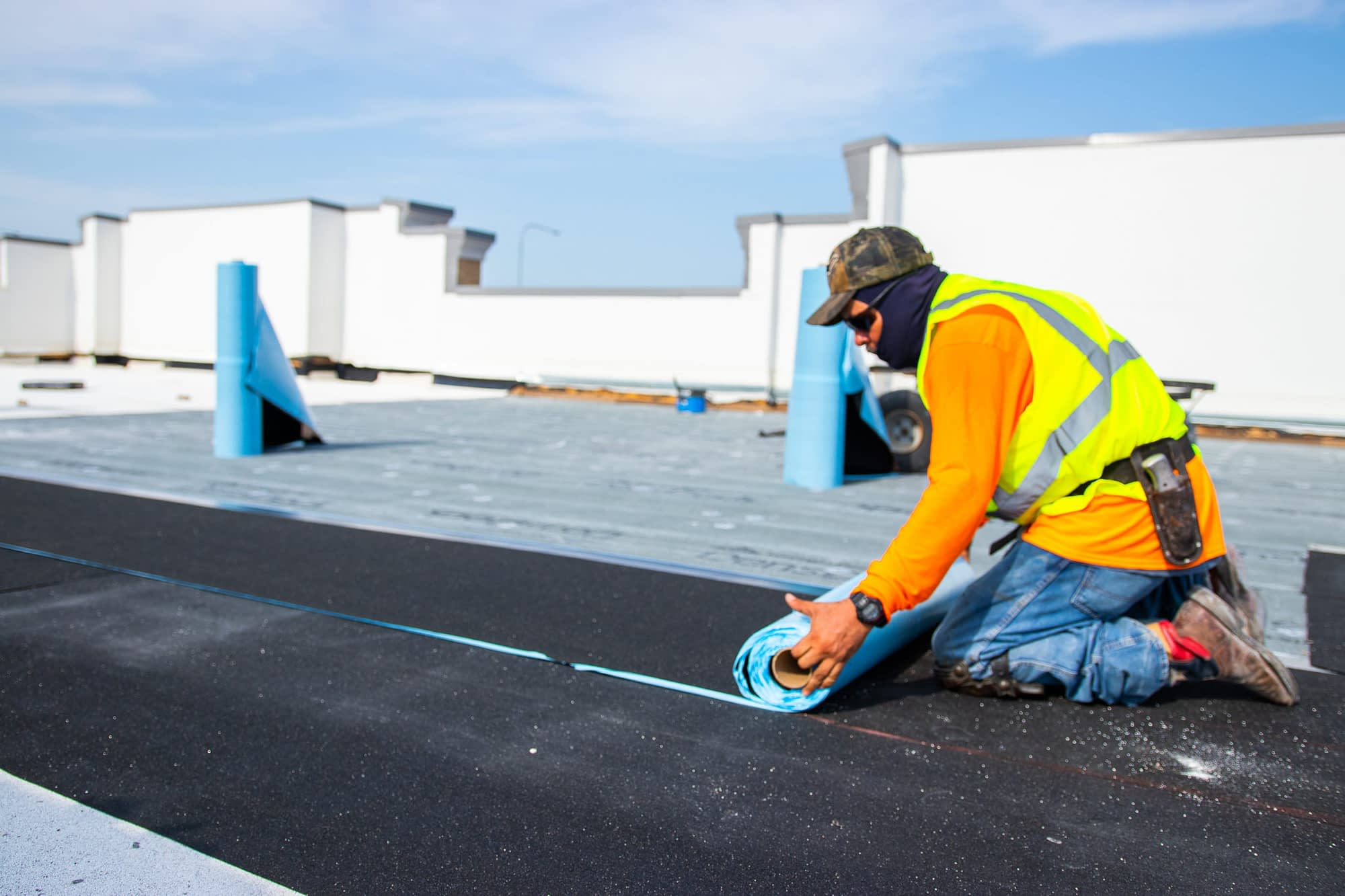 man doing commercial roof maintenance