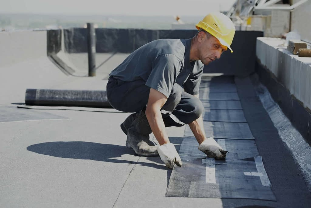 Professional roofer doing a commercial roof inspections
